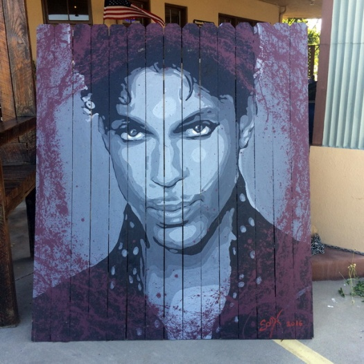prince-painting-on-picket-fence-at-park-and-2nd-antiques-in-sanford-florida