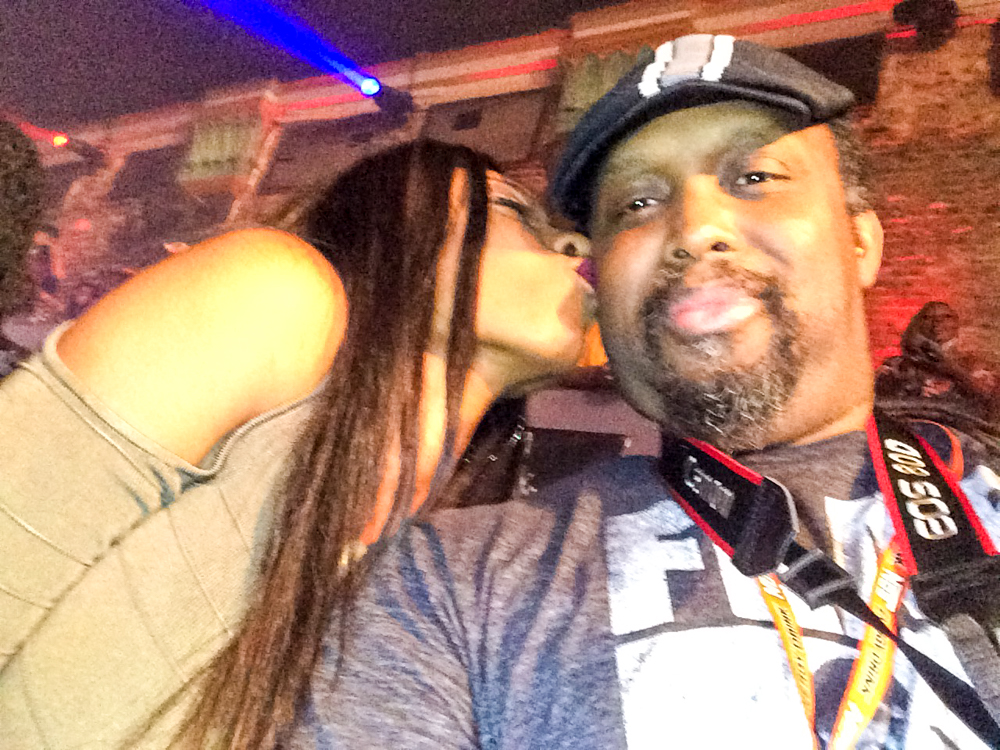 Me, Patrick Scott Barnes, receiving a kiss on the cheek by an Ebony beauty.
