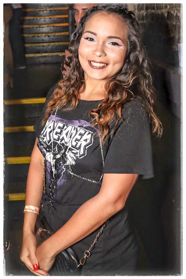 Smiling Hispanic girl in an Orlando nightclub.
