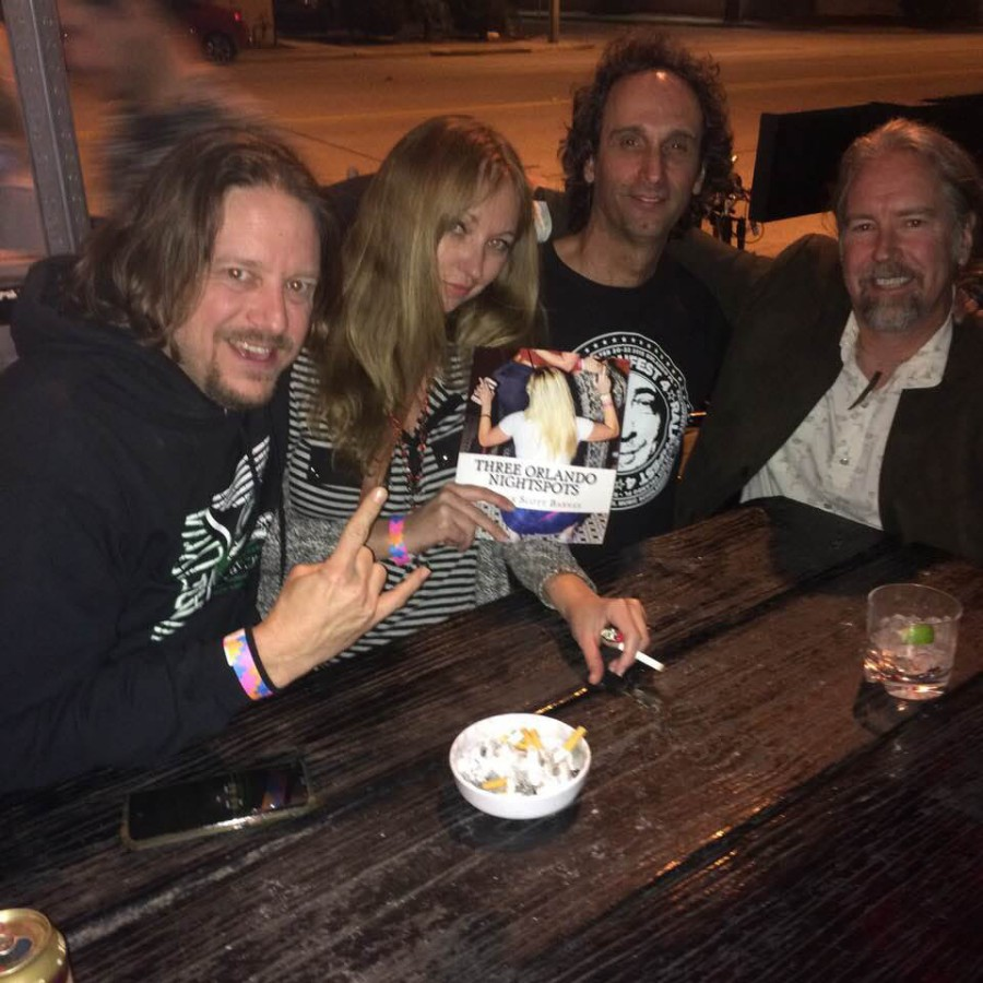 Jessica L Martens holding book at Will's Pub   Patrick Scott Barnes