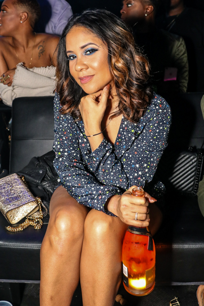 Angela Yee sitting in an Orlando nightclub's VIP section.