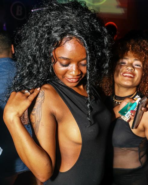 Ebony girl and Hispanic girl smiling.