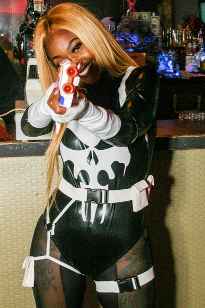 Sexy babe aiming toy gun at viewer in an Orlando nightclub.