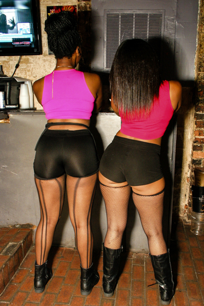 Big booty duo of black women in a nightclub.