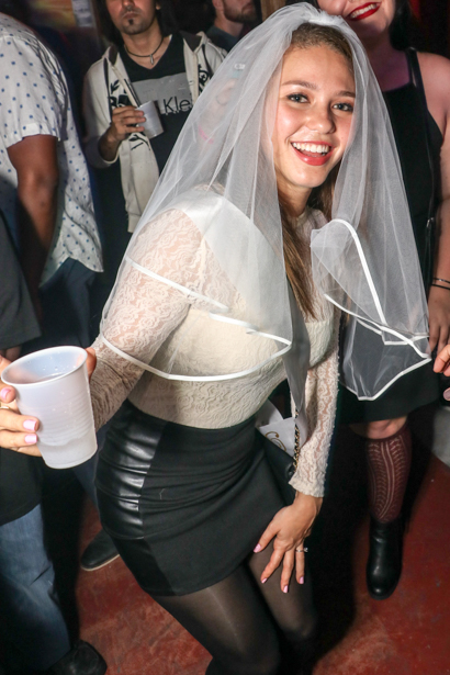 Young brunette wearing a bridal veil in a Downtown Orlando bar.