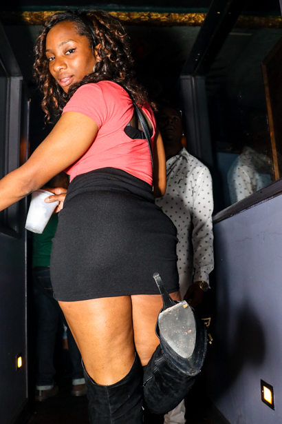 Young black woman posing her booty in an Orlando nightclub.