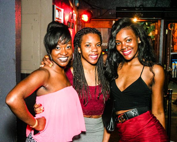 Three Black women posing in a Downtown Orlando nightclub.