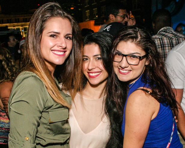 Three smiling young women in a Downtown Orlando spot.