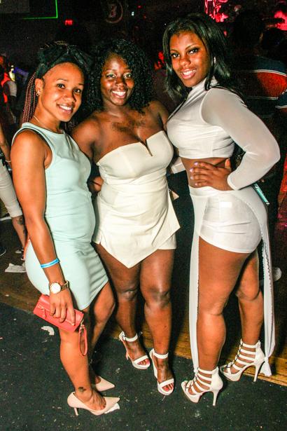 Three smiling black women in a Downtown Orlando nightclub.
