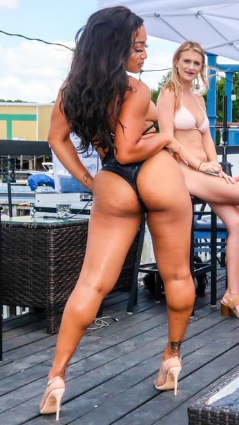 Black woman wearing a black bikini in Sanford, Florida.