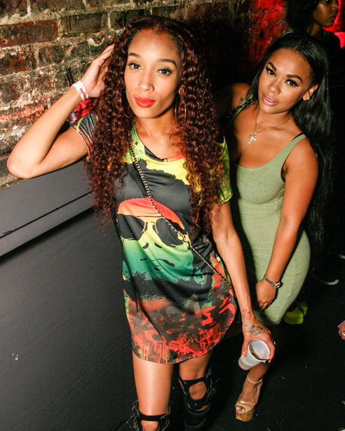 Two young black women in a Downtown Orlando nightclub.