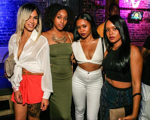 Four pretty ebony women in a nightclub.