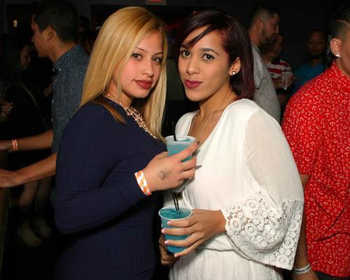 Two smiling Hispanic women in a Downtown Orlando nightclub.