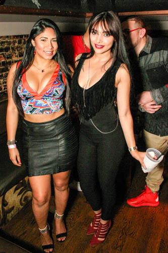 Two Hispanic women in an Orlando nightclub.
